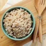 bowl of brown rice with utensils