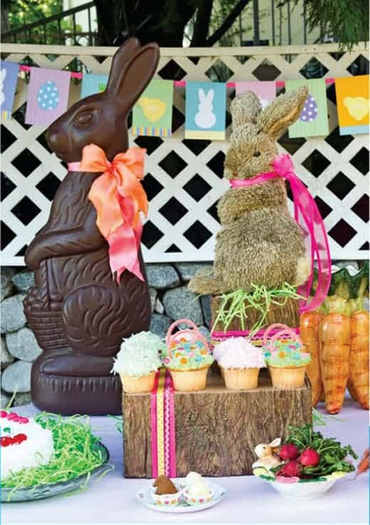 chocolate bunny and stuffed bunny with spring flag banner