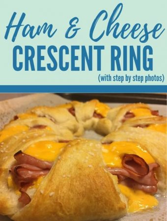 Ham and cheese baked in crescent roll ring sprinkled with pretzel salt on a baking sheet
