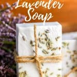 lavender soap wrapped with twine on wood counter with fresh lavender