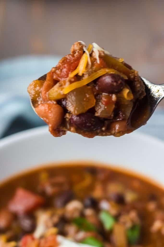 close-up of spoon full of crock pot irish chili