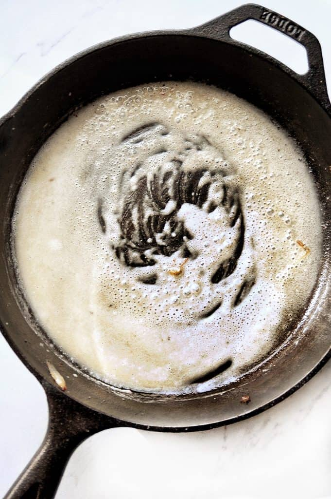 butter and flour cooking in cast iron skillet
