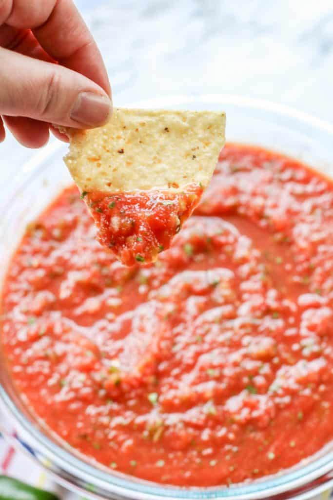 tortilla chip dipped in homemade salsa
