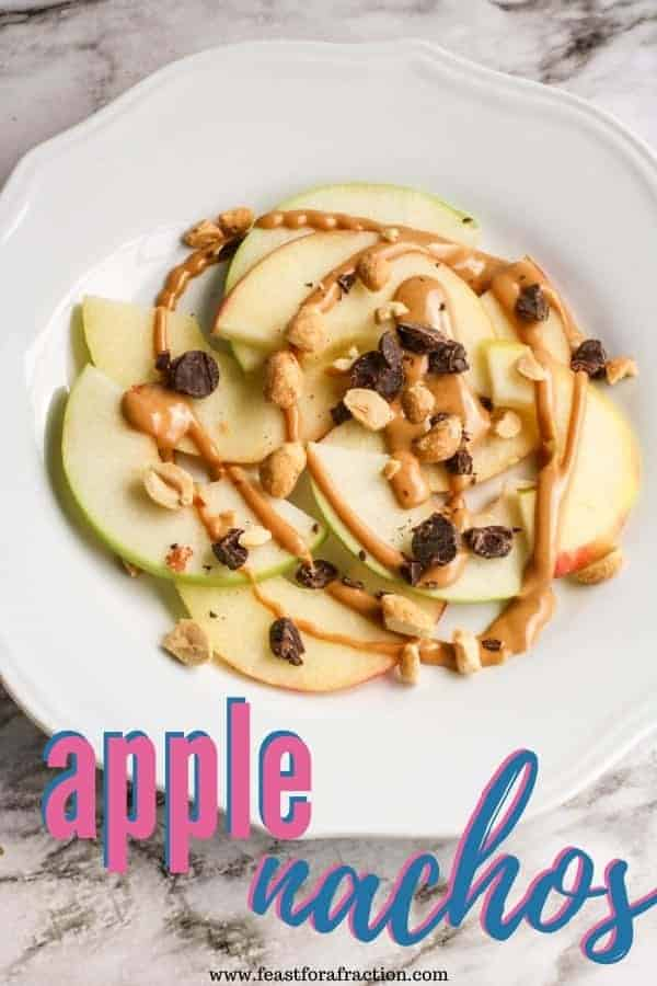 "sliced apples with peanut butter and chocolate on white plate with title text ""apple nachos"""