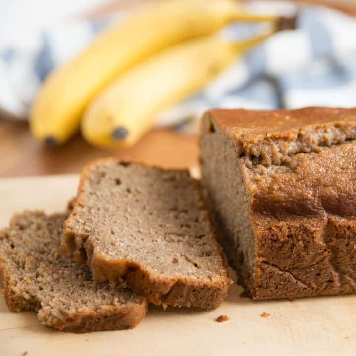 square image of applesauce banana bread loaf with two slices cut