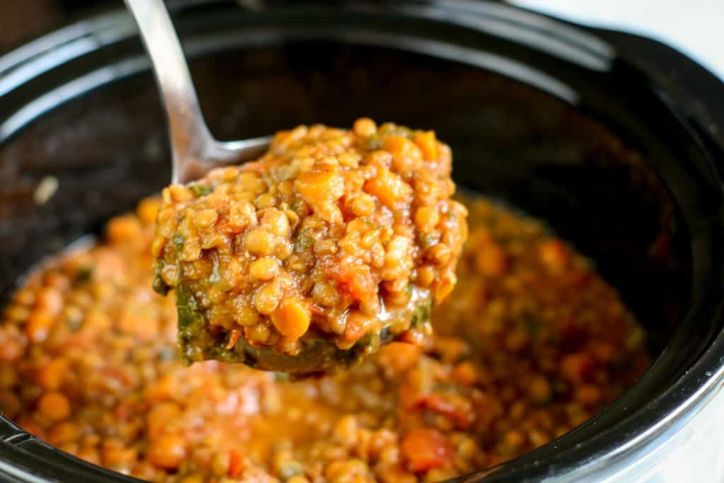 ladle filled with instant pot lentil soup