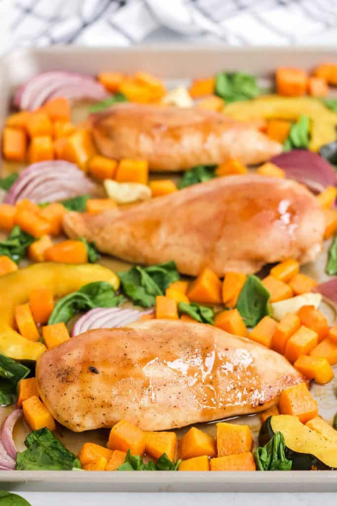 maple mustard chicken breast and roasted vegetables on sheet pan