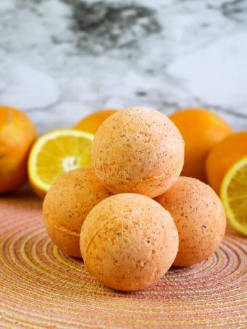diy bath bombs on orange placemat with orange slices