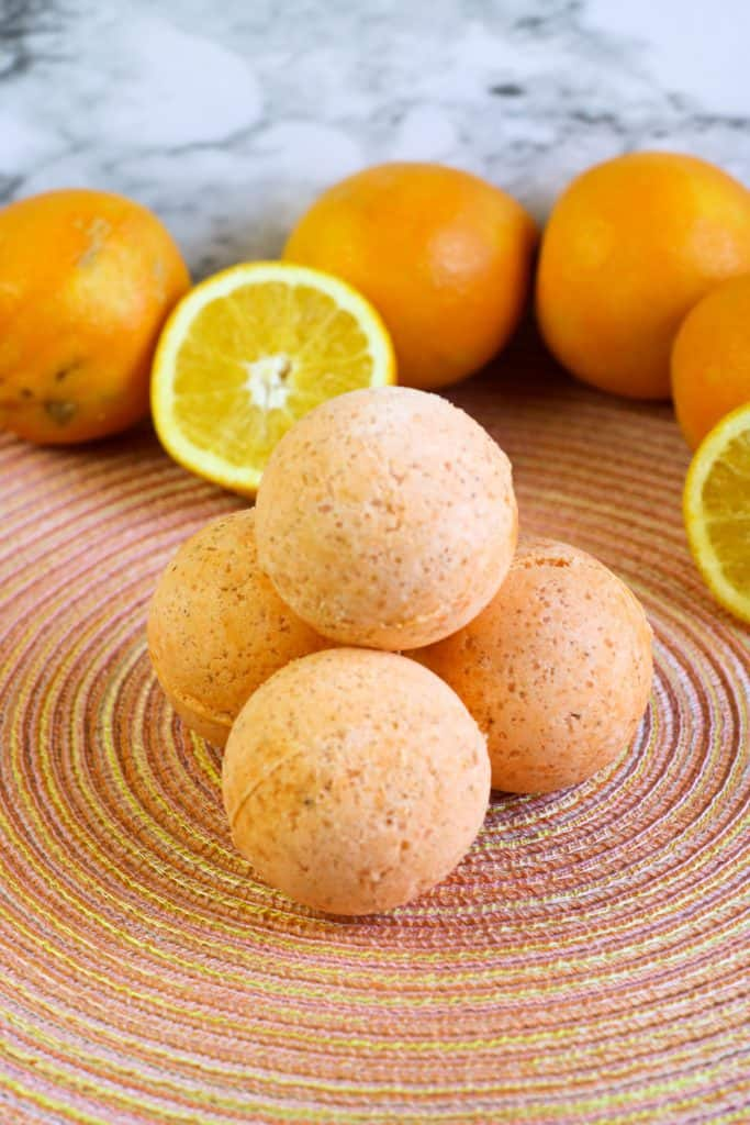 diy bath bombs and oranges on colorful placemat