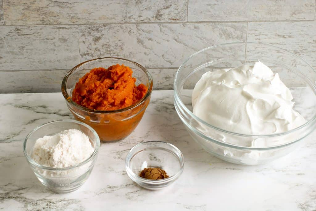 pumpkin puree, instant vanilla pudding, cool whip and pumpkin pie spice in glass bowls
