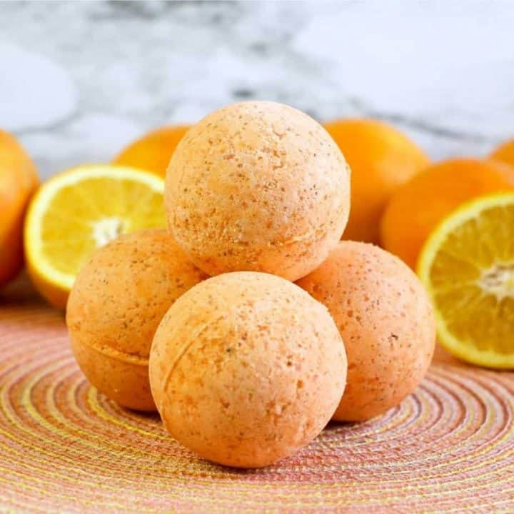 square image of diy bath bombs with whole and sliced oranges