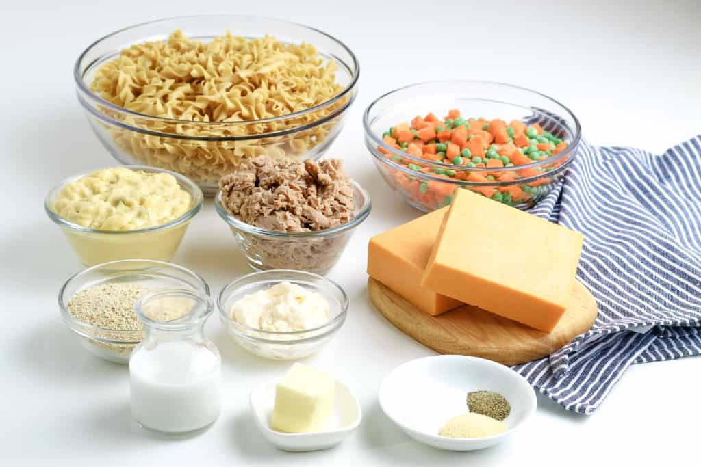 tuna noodle casserole ingredients in glass bowls