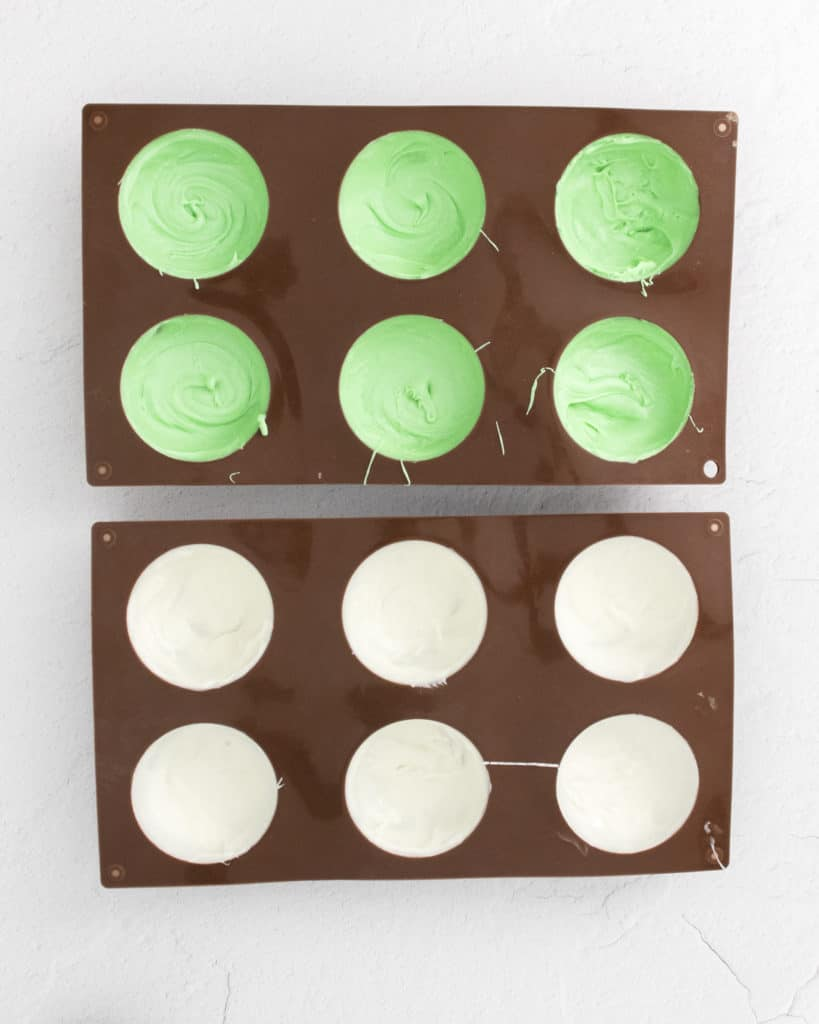 green and white candy melts in hot chocolate bomb molds