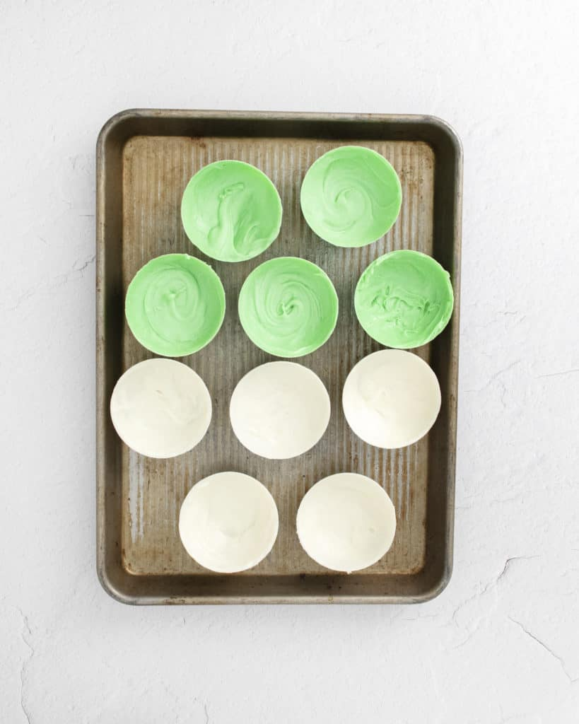 green and white chocolate shells on sheet pan