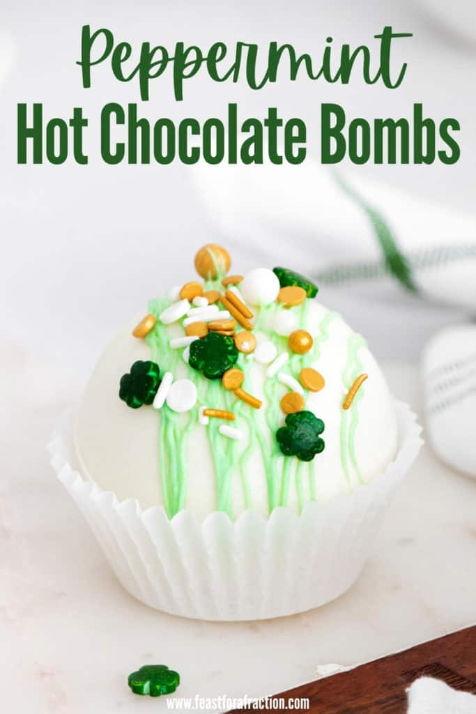 "side angle image of hot chocolate bomb with title text ""Peppermint Hot Chocolate Bombs"""