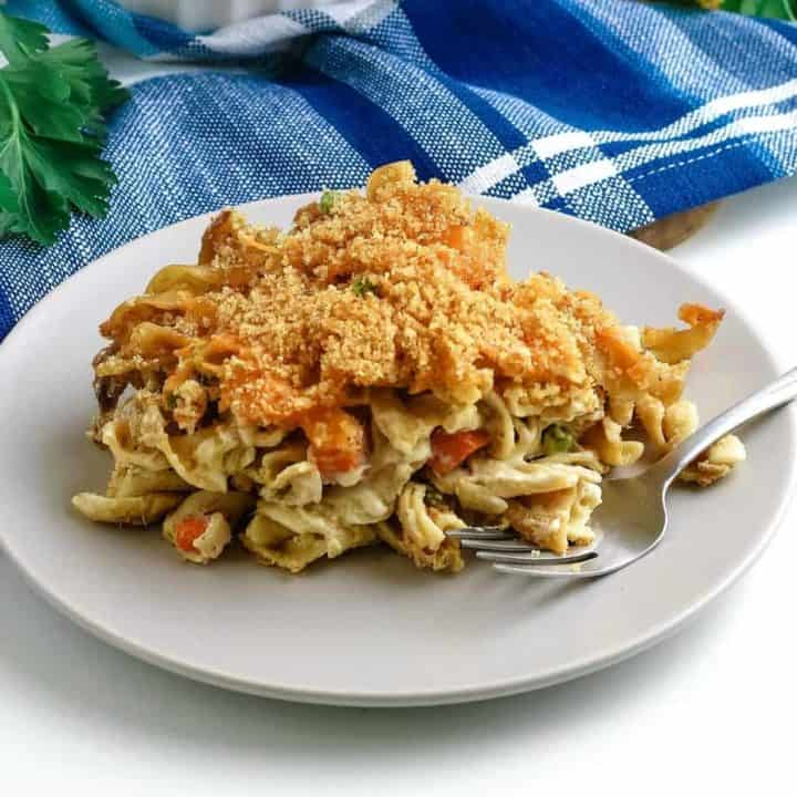 baked tuna noodle casserole on white plate with fork