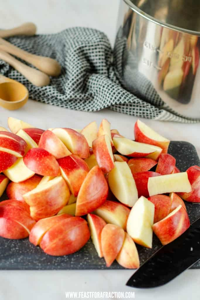 sliced apples on cutting board with instant pot liner in background