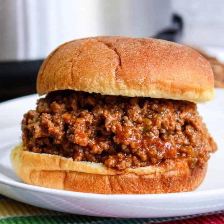 close up of sloppy joes sandwich on white plate